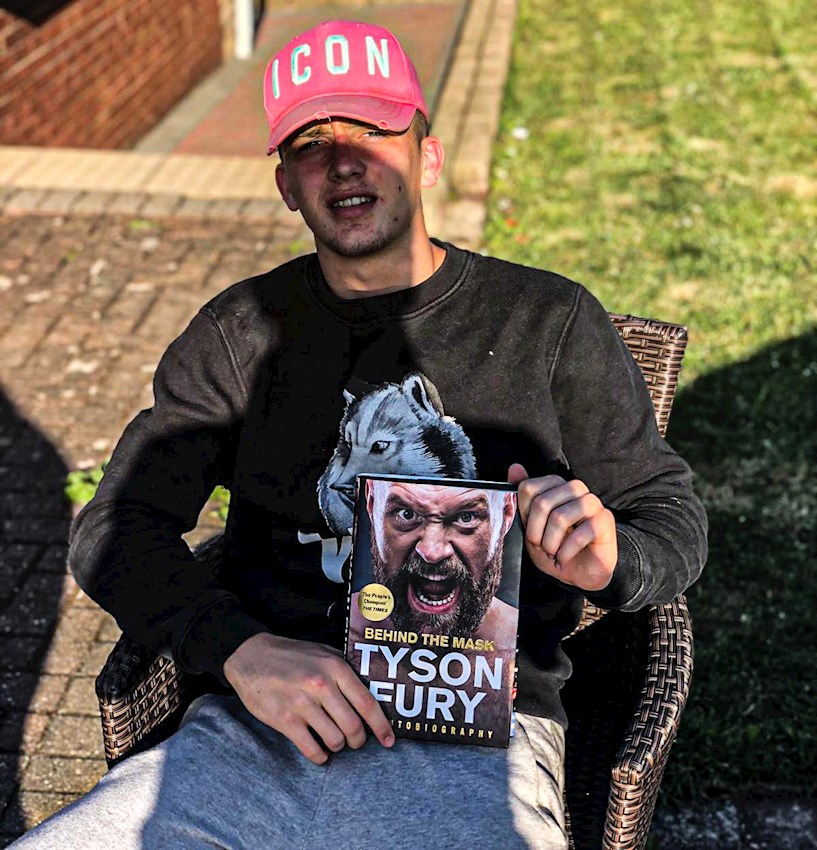 Keaton Ward with his Tyson Fury autobiography