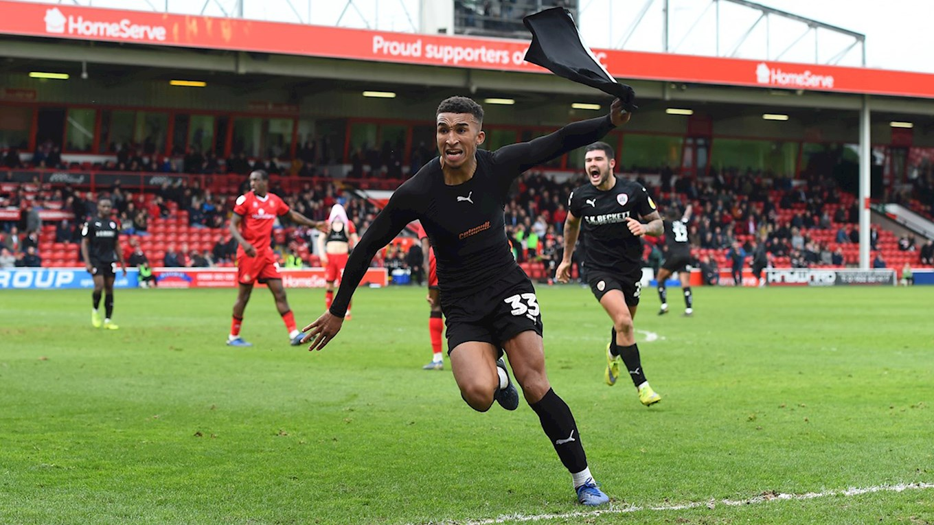 Jacob Brown celebrates scoring a late winner at Walsall