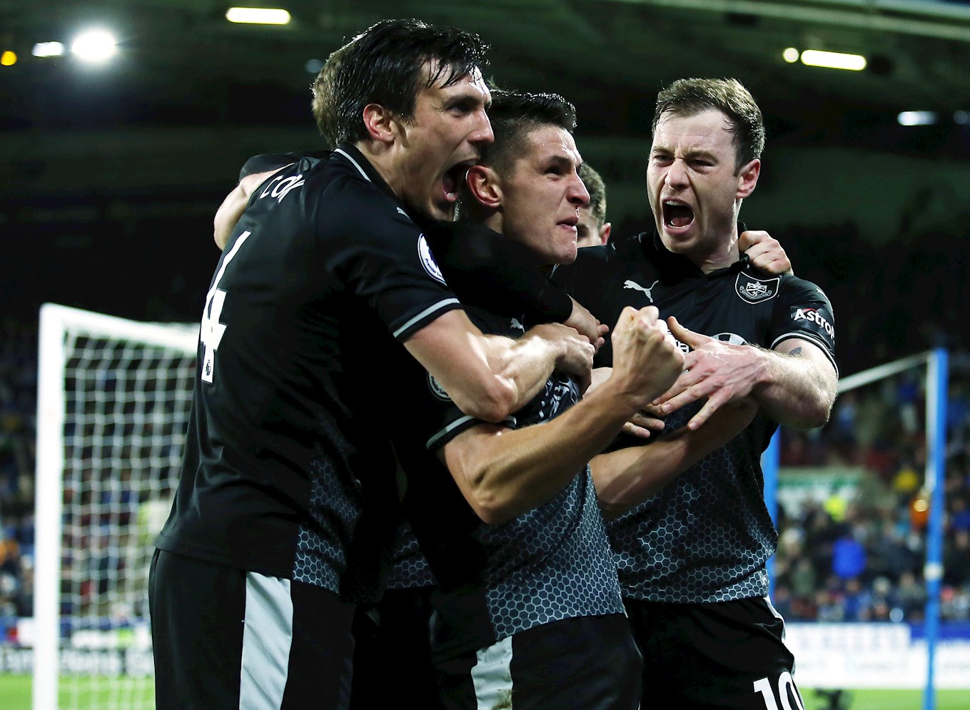 Burnley celebrate win at Huddersfield