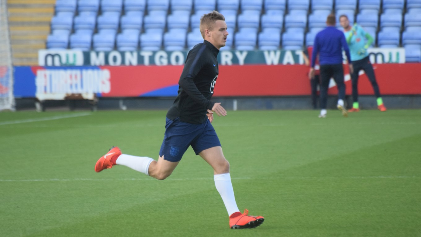 Luke Thomas warming up for England U20s
