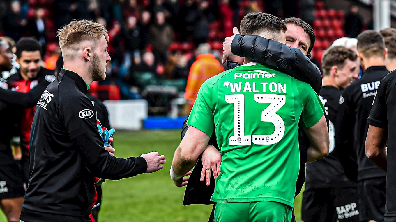 Jack Walton embraced at full-time by Daniel Stendel