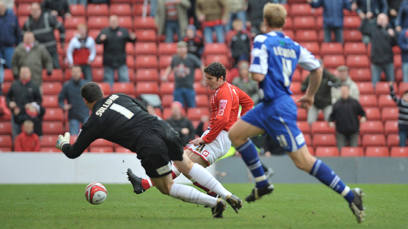 Macken rounds Neil Sullivan to score against Doncaster Rovers.