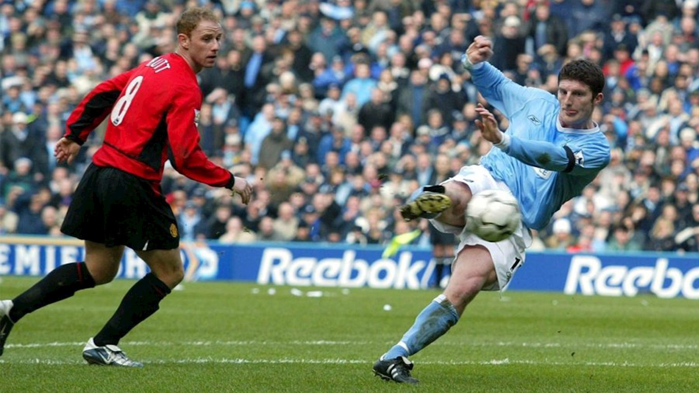 Macken scores City's second as they beat United 4-1 in the derby.