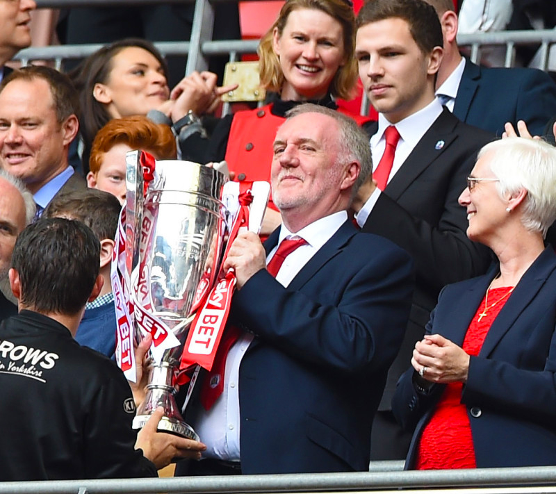 Patrick lifts the League One Playoff Trophy at Wembley